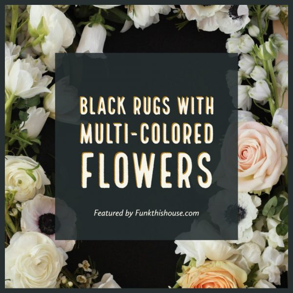 Multi Colored Flowers on a Black Rug